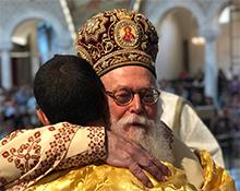 OCMC missionary embraced by His Beatitude Archbishop Anastasios of Albania
