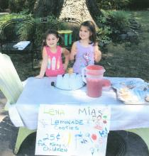 Youth involved in missions hosting a lemonade stand for Kenya