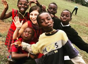 Team member and kids in Ghana in 2017